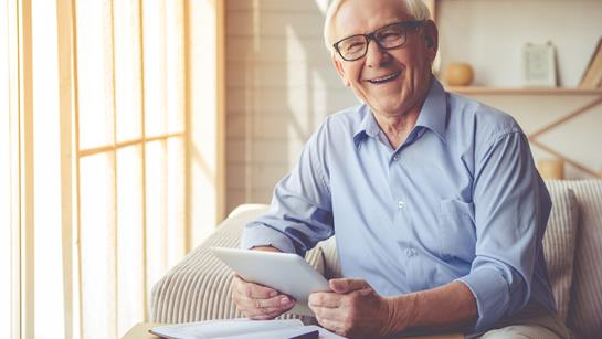Older Man Happy At Home With Ipad